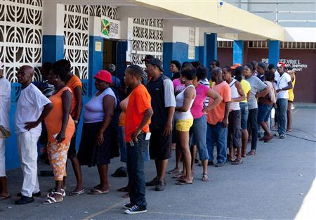 Voters wait in line outside a poling station during the Jamaican General Elections in Kingston December 29, 2011. REUTERS/A. Gilbert Bellamy