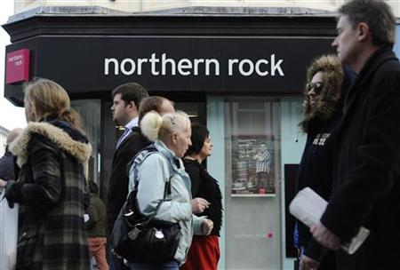 People pass a branch of Northern Rock bank in Newcastle, northern England November 17, 2011. REUTERS/Nigel Roddis