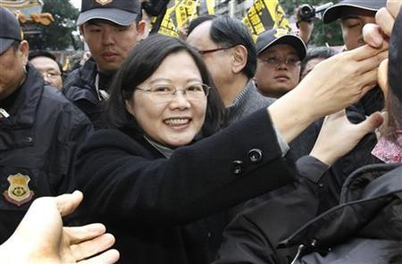 Taiwan's main opposition Democratic Progressive Party (DPP) Chairperson and presidential candidate Tsai Ing-wen greets supporters during a campaign rally in Xinbei city December 19, 2011. REUTERS/Shengfa Lin