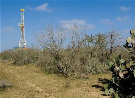 A drilling rig in the Eagle Ford Shale in South Texas is seen in this Petrohawk Energy Corporation handout photograph released to Reuters on July 14, 2011. REUTERS/Petrohawk Energy Corporation/Handout