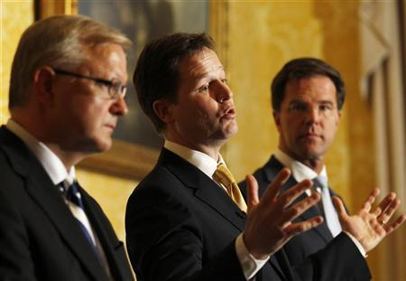 Britain's Deputy Prime Minister Nick Clegg (C) speaks alongside European Union Economic and Monetary Affairs Commissioner Olli Rehn (L) and the Prime Minister of the Netherlands Mark Rutte at a meeting of European Liberal Democrats in Government, at Admiralty House, in London January 9, 2012. REUTERS/Luke MacGregor