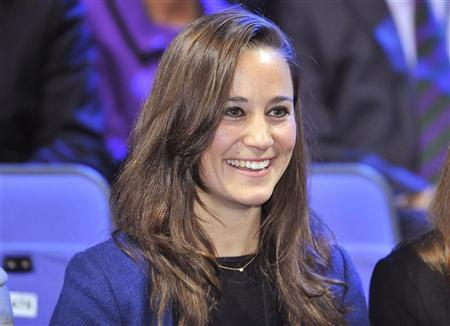 Pippa Middleton watches the men's singles tennis final between Jo-Wilfried Tsonga of France and Roger Federer of Switzerland at the ATP World Tour Finals at the O2 Arena in London November 27, 2011. REUTERS/Toby Melville