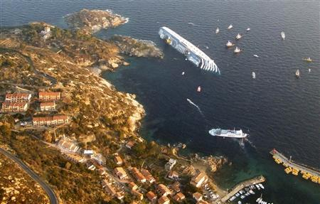 Costa Concordia cruise ship that ran aground is seen off the west coast of Italy at Giglio island January 14, 2012. At least three people were killed and rescuers were searching for other victims after an Italian cruise ship carrying more than 4,000 people ran aground and keeled over in shallow waters. REUTERS/Italian Guardia di Finanza