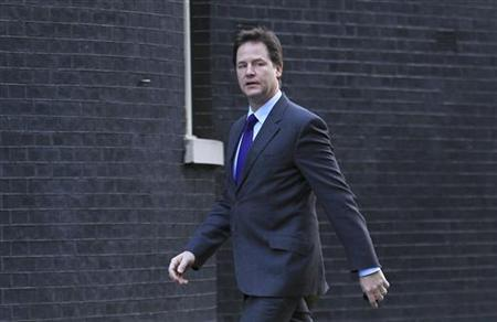 Deputy Prime Minister Nick Clegg arrives for a cabinet meeting at Downing Street in central London on December 13, 2011. REUTERS/Olivia Harris