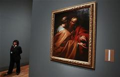 "<p>A worker stands by the painting ""San Pedro y San Pablo"" (Saint Peter and Saint Paul) by Spanish artist Jose de Ribera during a preview of the upcoming exhibition ""The Young Ribera"" at Madrid's El Prado museum April 1, 2011. REUTERS/Andrea Comas</p>"