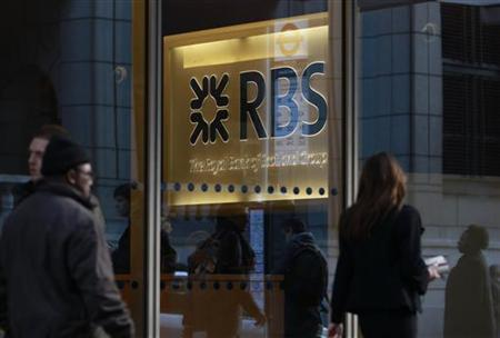 People walk past a Royal Bank of Scotland (RBS) building in the City of London January 12, 2012. REUTERS/Stefan Wermuth