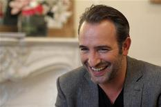 "<p>French actor Jean Dujardin speaks during an interview about the film ""The Artist"" in Paris January 24, 2012. REUTERS/Philippe Wojazer</p>"