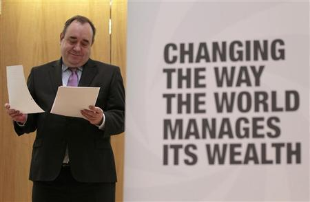 Scotland's First Minister Alex Salmond looks at his notes during the opening ceremony for the global headquarters of wealth managers FNZ, in Edinburgh, Scotland January 19, 2012. REUTERS/David Moir