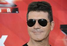 "<p>Judge Simon Cowell poses for photographers following a news conference for the television show ""The X Factor"" held in Los Angeles December 19, 2011. REUTERS/Phil McCarten</p>"