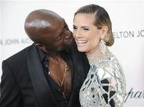 <p>British musician Seal kisses his wife, German model and television personality Heidi Klum, as they arrive at the 19th Annual Elton John AIDS Foundation Academy Award Viewing Party in West Hollywood, California February 27, 2011. REUTERS/Gus Ruelas</p>