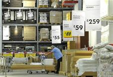 <p>A shopper pushes goods at the Wembley branch of the Swedish international furniture and home accessories company Ikea in west London October 15, 2010. REUTERS/Toby Melville</p>
