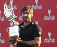 <p>Robert Rock of England poses with the trophy after winning the Abu Dhabi Championship at the Abu Dhabi Golf Club January 29, 2012. REUTERS/Joseph J. Capellan</p>