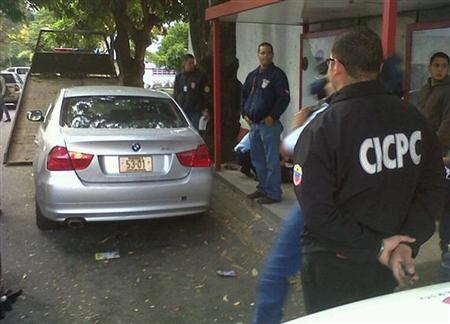 Police officials inspect the car of Mexico's ambassador to Venezuela in Caracas January 30, 2012. Mexico's ambassador to Caracas and his wife were kidnapped overnight and then freed on Monday in the latest high profile abduction in Venezuela, where violent crime is routinely listed as citizens' No. 1 worry. In the typical style of ''express'' kidnappings that are rife in the South American country, four armed men seized envoy Carlos Pujalte and his wife as they left a reception in the capital's wealthy Country Club neighbourhood by car at around midnight (0430 GMT), diplomats and officials said. REUTERS/Gustavo Gomez