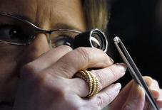 <p>Buyer Lotta Torstensson of Sweden inspects a 0.90 carat diamond valued at $3,000 at the 3rd Antwerp Diamond Trade Fair in Antwerp January 31, 2012. REUTERS/Francois Lenoir</p>