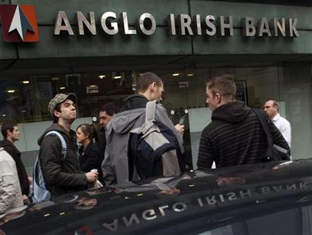 Pedestrians walk past the Anglo Irish Bank head offices, in Belfast March 25, 2010. REUTERS/Cathal McNaughton