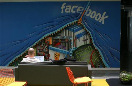 An employee works on a computer at the new headquarters of Facebook in Menlo Park, California January 11, 2012. REUTERS/Robert Galbraith
