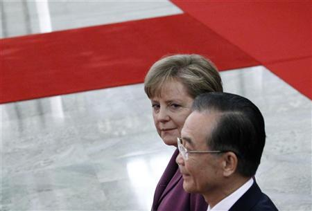 German Chancellor Angela Merkel (L) walks next to Chinese Premier Wen Jiabao during an official welcoming ceremony in the Great Hall of the People in Beijing February 2, 2012. REUTERS/David Gray