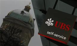 <p>A UBS logo is pictured on a UBS bank building in front of the Swiss federal parliament building in Bern February 1, 2012 REUTERS/Pascal Lauener</p>