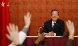 <p>Chinese Premier Wen Jiabao reacts during a news conference in Doha January 18, 2012. REUTERS/Mohammed Dabbous</p>