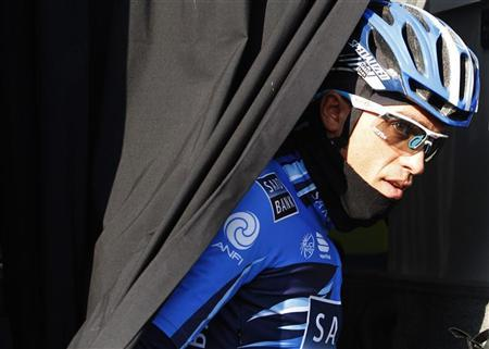 Saxo Bank-Sungard rider Alberto Contador leaves the team bus before the start of the first stage of the Challenge Mallorca cycling tour in Palma de Mallorca on the Spanish Balearic island of Mallorca February 5, 2012. REUTERS/Enrique Calvo