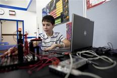 <p>Bryan Molina a 8th grader works on his robot in the bilingual, project lead the way class at Escuela Vieau Middle School in Milwaukee, Wisconsin January 26, 2012. REUTERS/Darren Hauck</p>