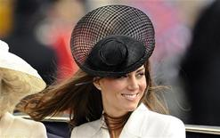 <p>Britain's Catherine, Duchess of Cambridge smiles as she rides to Buckingham Palace after attending the Trooping the Colour ceremony in central London June 11, 2011. Trooping the Colour is a ceremony to honour the sovereign's official birthday. REUTERS/Dylan Martinez</p>