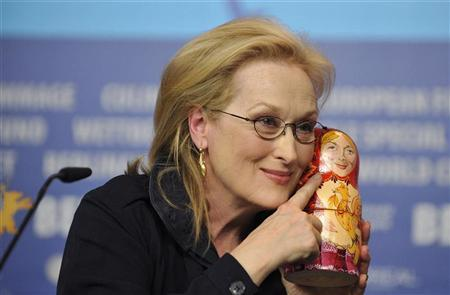 Meryl Streep poses with a matryoshka doll she received as a gift from a Russian journalist during a news conference to promote the movie ''The Iron Lady'' at the 62nd Berlinale International Film Festival in Berlin February 14, 2012. REUTERS/Morris Mac Matzen
