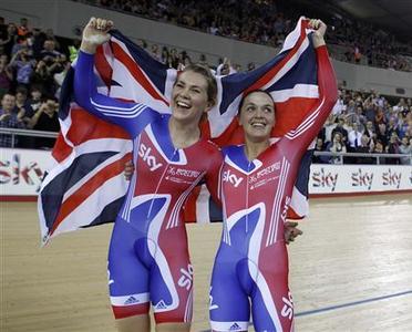 Team Britain cyclists Jess Varnish (L) and Victoria Pendleton celebrate winning the Gold Medal in the Women's Team Sprint Final at the UCI Track Cycling World Cup at the Olympic Velodrome in London February 17, 2012. REUTERS/Eddie Keogh
