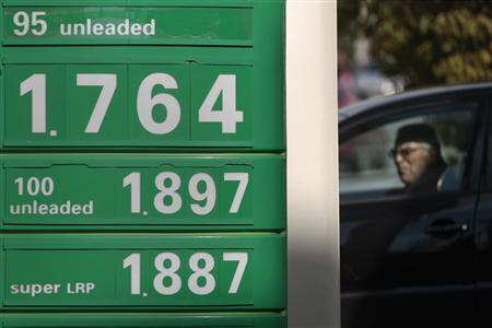 A driver leaves a gas station in Athens February 21, 2012. Oil held near $120 a barrel on Tuesday as world consumers grappled with supply disruptions ranging from Iran to Sudan to the North Sea. Oil also rose briefly after Europe's much-awaited bailout of Greece. REUTERS/Yiorgos Karahalis