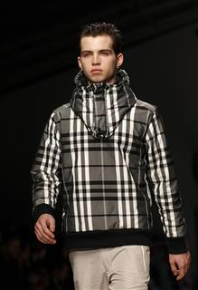 A model presents a creation at the Christopher Shannon 2012 Autumn/Winter collection show during London Fashion Week February 22, 2012. REUTERS/Suzanne Plunkett