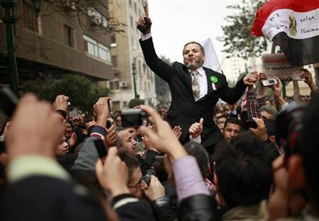 Muslim Brotherhood supporters celebrate outside Egypt's parliament in Cairo January 23, 2012. REUTERS/Suhaib Salem
