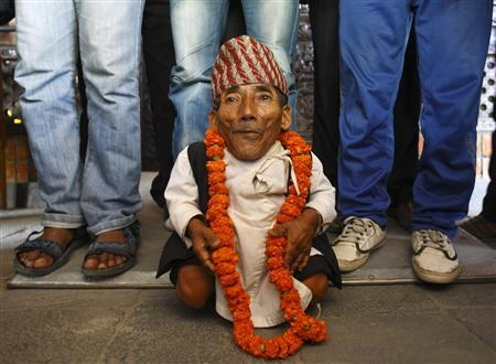 Chandra Bahadur Dangi, 72, poses for a picture after being announced as the world's shortest man living, as well as shortest person ever measured by the Guinness World Records, in Kathmandu February 26, 2012. REUTERS/Navesh Chitrakar