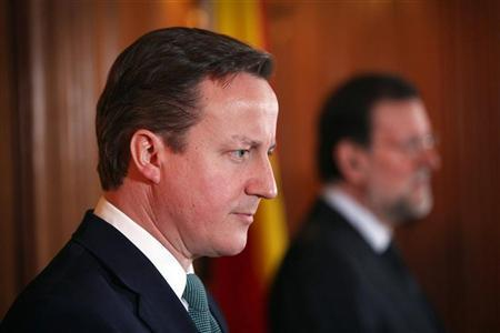 Spain's Prime Minister Mariano Rajoy (R) speaks during a joint news conference with Britain's Prime Minister David Cameron in 10 Downing Street in central London February 21, 2012. REUTERS/Peter Macdiarmid/Pool