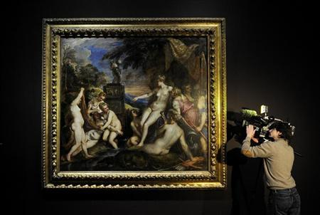 A television camera operator films Titian's 'Diana and Callisto' at the National Gallery in London, March 1, 2012. REUTERS/Paul Hackett
