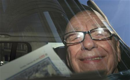 The Chairman and CEO of News Corporation, Rupert Murdoch, is driven away from his home in central London February 26, 2012. REUTERS/Olivia Harris