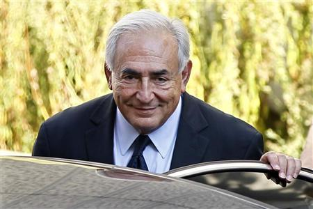 Former IMF chief Dominique Strauss-Kahn leaves the financial brigade in Paris September 29, 2011. REUTERS/Charles Platiau
