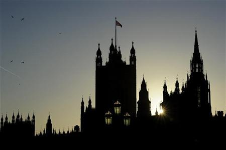 The sun sets behind The Houses of Parliament in central London, January 15, 2012. REUTERS/Paul Hackett