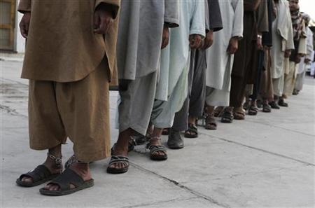 Prisoners who escaped from Kandahar's Sarposa jail on Monday are presented to the media after they were recaptured, in Kandahar April 26, 2011. REUTERS/Ahmd Nadeem