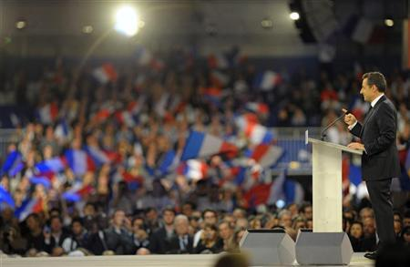 France's President and UMP party candidate for the 2012 French presidential elections Nicolas Sarkozy delivers a speech during a political rally in Villepinte, Paris suburb March 11, 2012. REUTERS/Philippe Wojazer