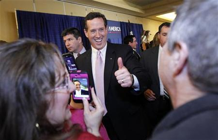 Republican U.S. presidential candidate and former U.S. Senator Rick Santorum gives a thumbs up to supporters after speaking at his Alabama and Mississippi primary election night rally in Lafayette, Louisiana, March 13, 2012. REUTERS/Mike Stone