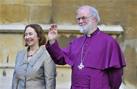 Britain's Archbishop of Canterbury Rowan Williams (R) and his wife Jane wave to Queen Elizabeth and Prince Philip after a Diamond Jubilee multi-faith reception at Lambeth Palace in central London February 15, 2012. REUTERS-Toby Melville