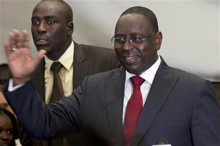 Senegalese opposition presidential candidate Macky Sall (R) celebrates at a news conference in Dakar March 25, 2012. REUTERS/Joe Penney