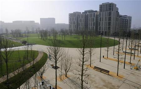 The Olympic Park is seen from the balcony of an apartment block at the athlete's village in Stratford, east London March 15, 2012. REUTERS/Dominic Lipinski/pool