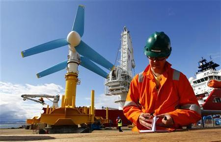 An engineer works near the Atlantis Resources AK-1000 tidal energy turbine before it is shipped to the European Marine Energy Centre test site in the Orkney Islands from the port at Invergordon, northern Scotland August 12, 2010. REUTERS/David Moir