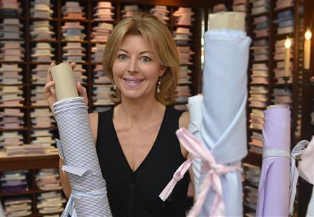 Bespoke shirtmaker Emma Willis poses for a photograph in her shop in Jermyn Street in central London March 23, 2012. REUTERS/Toby Melville