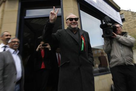 Respect Party candidate George Galloway gestures as he arrives at his campaign office in Bradford, northern England, March 30, 2012. REUTERS/Darren Staples
