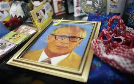 A photo of GDR politican Erich Honecker is pictured in a room at the ''Ostel'' hotel in Berlin June 28, 2007. REUTERS/Hannibal Hanschke