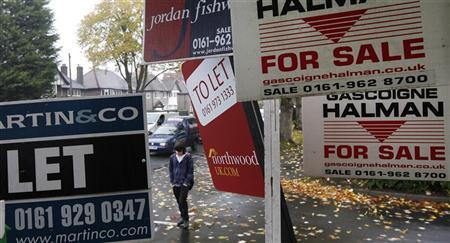 A man walks past property for sale and rent in Timperley, northern England, November 1, 2010. REUTERS/Phil Noble