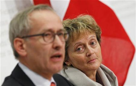 Swiss President and Finance Minister Eveline Widmer-Schlumpf (R) and Swiss Secretary of State in the finance department Michael Ambuehl attend a news conference after signing the agreement on a deal on taxing secret offshore accounts between Switzerland and Germany in Bern April 5, 2012. The deal, which will take effect from 2013, will prevent one country's prosecutors from pursuing tax offences in the other country, says the finance ministry. REUTERS/Pascal Lauener