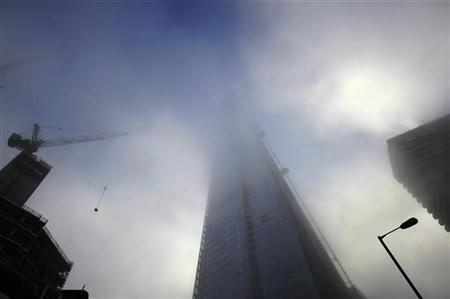 Fog during the early morning rush hour engulfs the Shard Building, being constructed in London March 15, 2012. REUTERS/Dylan Martinez